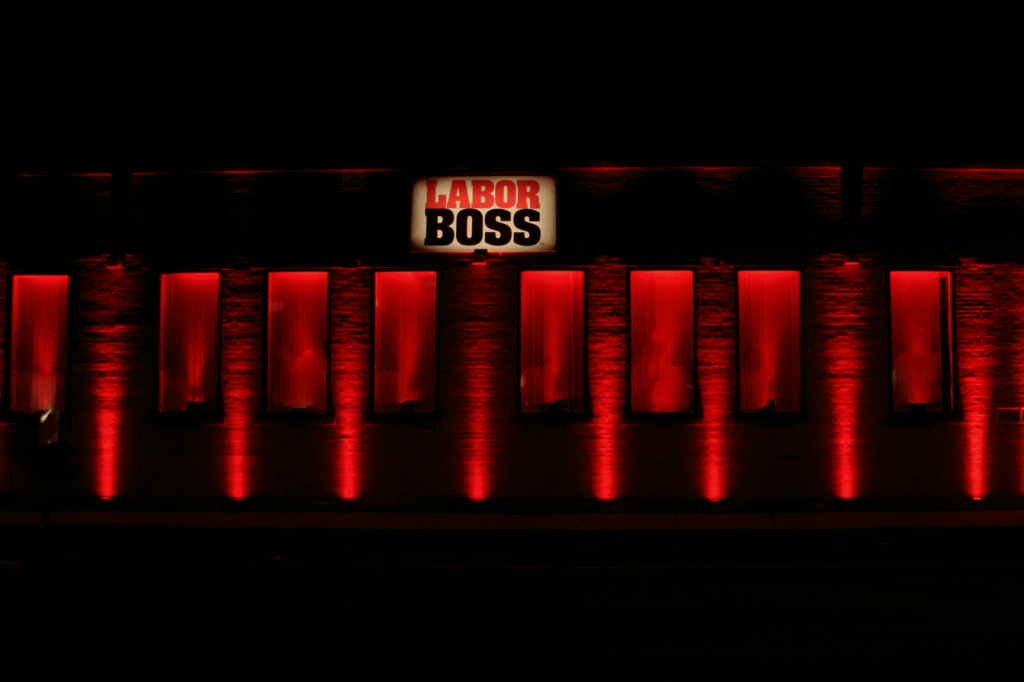 Photo of the front of the Labor Boss offices lit up in red to show support for #RedAlert #WeMakeEvents